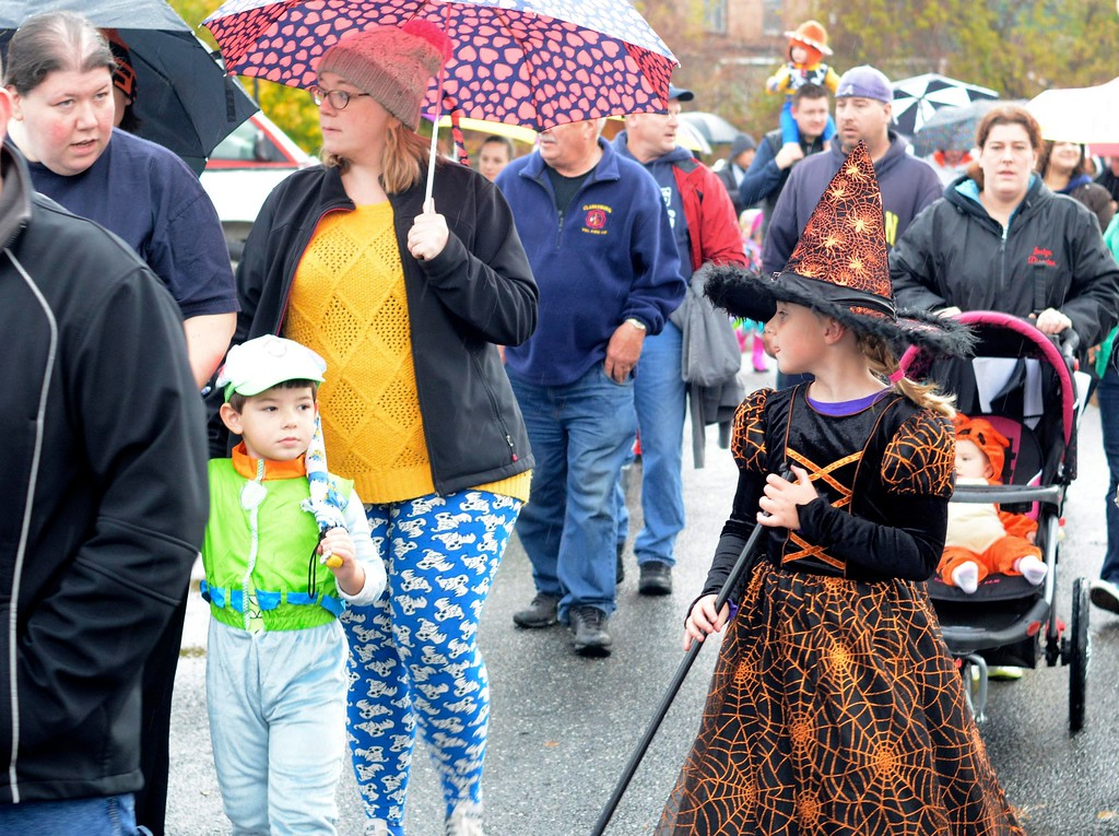 . Children and their parents take off from the Adams Community Bank as they march in the Adams Lions Club\'s annual Halloween Parade. Sunday October 30, 2016. Gillian Jones � The Berkshire Eagle
