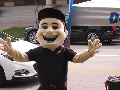 BOB FINNAN / GAZETTE The Domino's Pizza mascot hung out at the Pizza Palooza Saturday on Public Square in Medina.