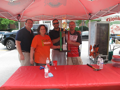 BOB FINNAN / GAZETTE Gionino's Pizzeria won the people's choice award at the Pizza Palooza Saturday on Public Square in Medina. Pictured are Sen. Larry Obhof, left, Sandy Hinkle of Feeding Medina County, and owners Gust Spilios and Andy Derr.