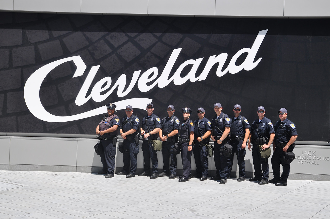 ASHLEY FOX / GAZETTE Indiana State Police take a few moments out of their patrolling duties on Thursday to take a photo marking their time in Cleveland during the Republican National Convention.