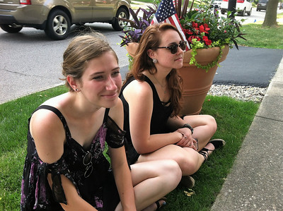 BOB SANDRICK / GAZETTE  Ally Campbell, left, and Samantha Navicky, both of Medina, listened to Colin Husbands, a folk singer, perform.