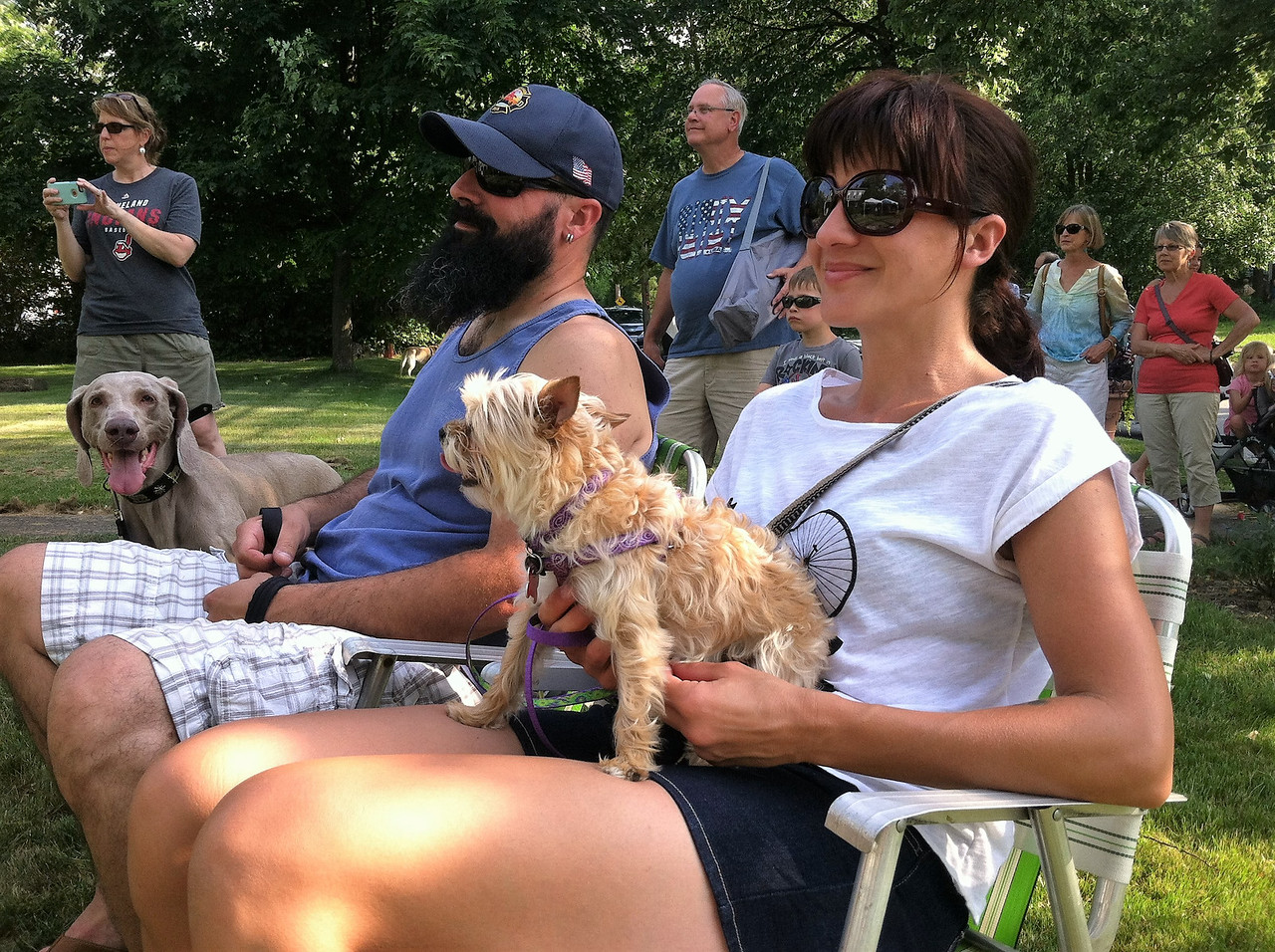 BOB SANDRICK / GAZETTE  The Herters of Medina, along with their little dog Pippi and their big dog Sage, enjoyed the Backroom Boys Bluegrass Band.