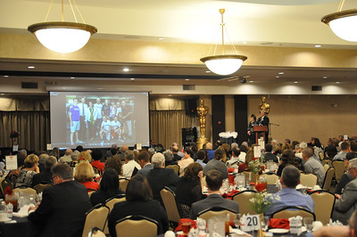 ASHLEY FOX / GAZETTE Rosie Award nominees and members of the community watch a video that describes each nominee at the Galaxy Banquet Center Wednesday evening.