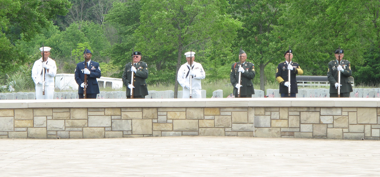 ELIZABETH DOBBINS / GAZETTE Members of the 555th Honors Detachment perform a rifle salute in Rittman.