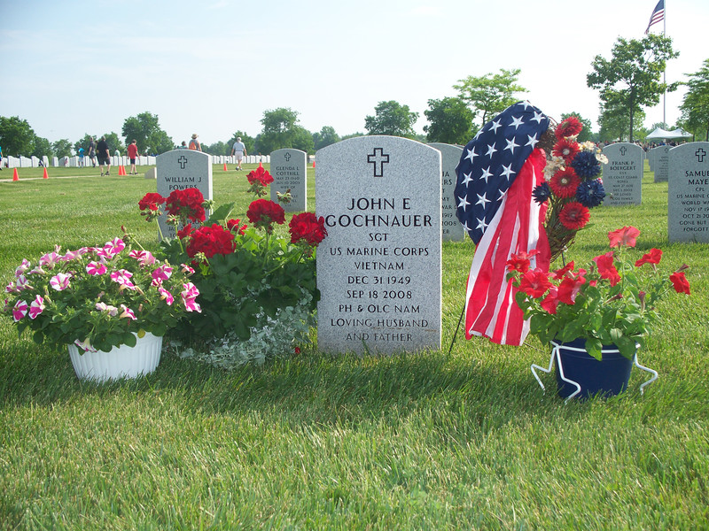 NIKKI RHOADES / GAZETTE Many graves at a Saturday decorating event at the Ohio Western Reserve National Cemetery in Rittman already had displays with patriotic themes.