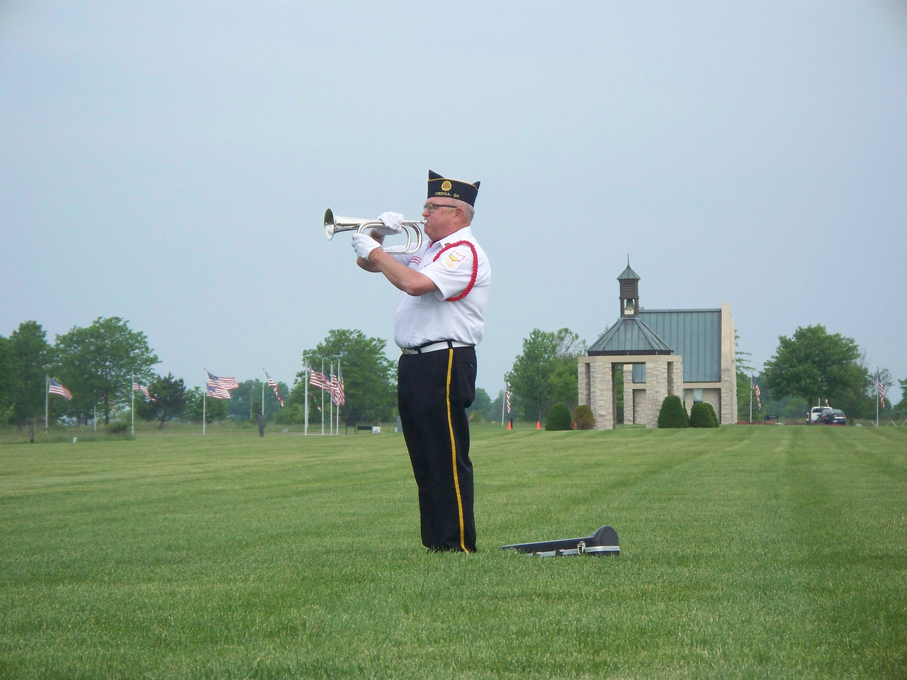 NIKKI RHOADES / GAZETTE A ceremony held Saturday as part of Memorial Day weekend at the Ohio Western Reserve National Cemetery in Rittman concluded with a rifle salute and the playing of Taps.
