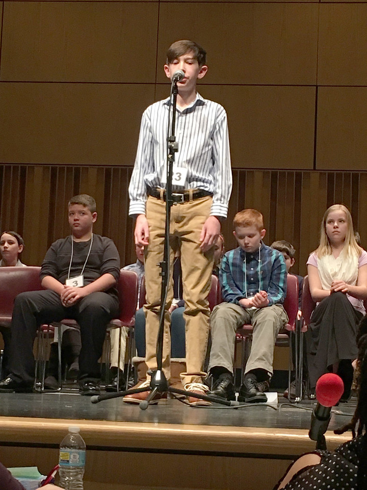"ASHLEY FOX / GAZETTE Ian Morgan, an eighth grader from Claggett Middle School, reached the eighth round of the Akron Regional Spelling Bee on Saturday. He missed ""discalced."""