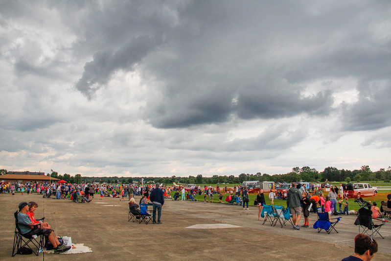 ALEC SMITH / GAZETTE A crowd of more than 1,000 turns out Saturday at Wadsworth Municipal Airport hoping to see a launch and return of 12 hot air balloons but threatening skies and weather conditions forced a cancellation. The event was free.