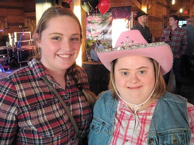 BOB SANDRICK / GAZETTE  Sisters Torie Craig, left, of Westfield Township, and Kayla Shields of Seville had fun Saturday at the Barn Bash, a fundraiser by a Medina nonprofit called Stand Up for Downs.
