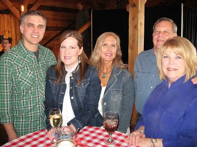 BOB SANDRICK / GAZETTE  From left, Jason and Sarah Horrigan of Medina, Tammy Pryatel of Medina and Lee and Debbie Eisinger of Akron attended the second Barn Bash, a fundraiser for Stand Up for Downs, on Saturday.