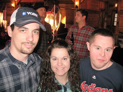 BOB SANDRICK / GAZETTE  From left, Justin and Jessi Munnich, and Jessi's brother Joe Bellottie, all of Elyria, enjoyed the Barn Bash on Saturday night.