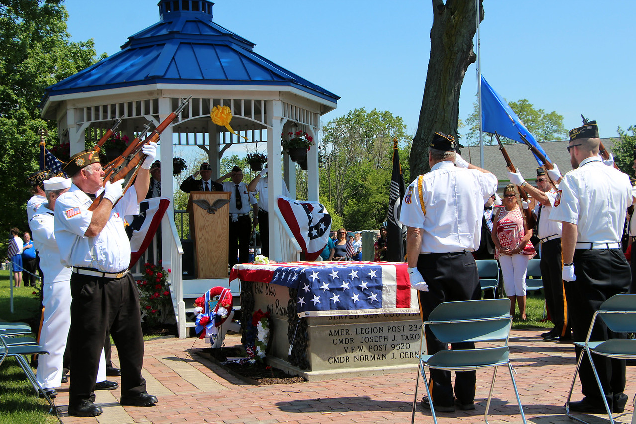 HALEE HEIRONIMUS / GAZETTE A rifle salute by American Legion Post 234 and Veterans of Foreign Wars Post 9520 concluded a Memorial Day ceremony at Westview Cemetery on Center Road Monday afternoon.