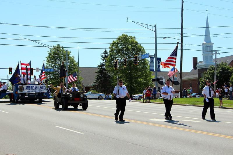 HALEE HEIRONIMUS / GAZETTE The Brunswick Legion Post 234 and Brunswick Veterans of Foreign Wars Post 9520 parade down Center Road to the Westview Cemetery on Monday morning.