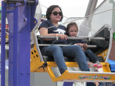 BOB SANDRICK / GAZETTE Tala McGloin and her 3-year-old daughter Stella of Akron ride the Ferris wheel on Saturday at the 2017 Summer Celebration in Brunswick.