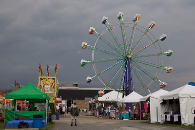 LUCAS FORTNEY / GAZETTE Guests trickle through the City of Brunswick's Summer Celebration grounds at 6 p.m., an hour after its opening. The festival has seen rain for two days in a row, with rain in today's forecast, as well.
