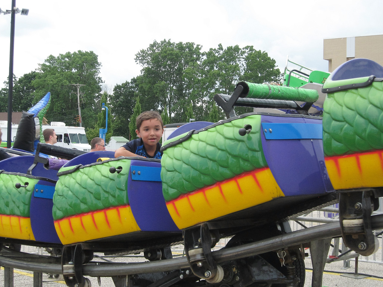 BOB SANDRICK / GAZETTE Danino Toth, 6, of Medina, looks out at his father while riding the Dragon Wagon on Saturday at the 2017 Summer Celebration in Brunswick.