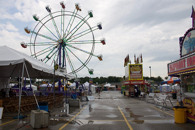 LUCAS FORTNEY / GAZETTE Guests trickle through the City of Brunswick's Summer Celebration grounds at 6 p.m. Friday, an hour after its opening. The festival has seen rain for two days in a row, with rain in today's forecast, as well.
