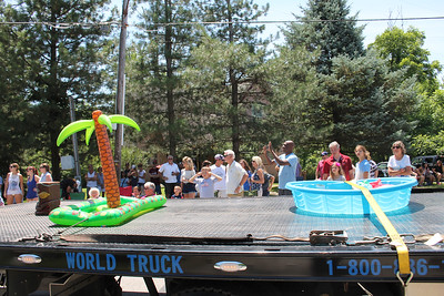"LAWRENCE PANTAGES / GAZETTE A children's wading pool and an inflatable palm tree help illustrate the theme ""tropical paradise"" for the 2017 Chippewa Lake July 4 parade held Tuesday."