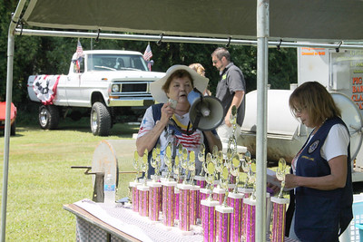 LAWRENCE PANTAGES / GAZETTE Chippewa Lake Village Mayor Joanne Dodaro makes announcements about the July 4 parade honors Tuesday at the Chippewa Lake Lions Club park. Shown at right is Lions Club member Cyndy Naragon.