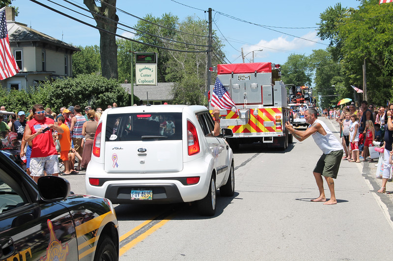 LAWRENCE PANTAGES / GAZETTE Photographers and videographers capture images Tuesday during the July 4 parade in the village of Chippewa Lake.
