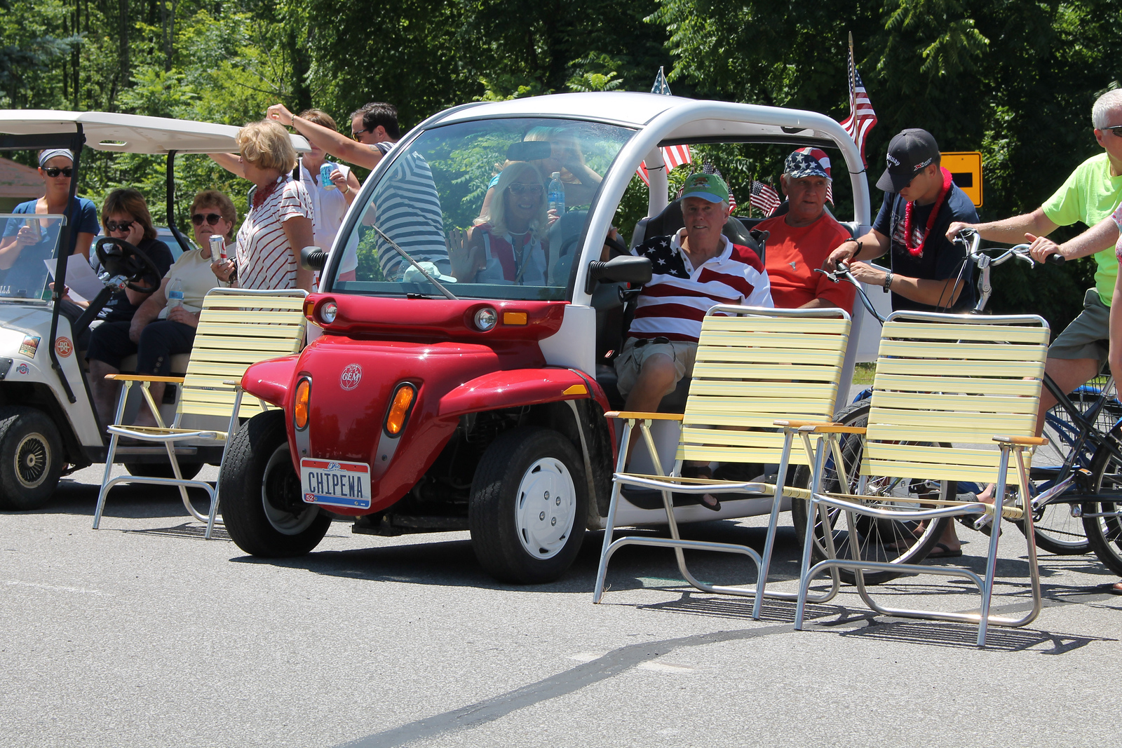 LAWRENCE PANTAGES / GAZETTE Paul and Pam Vereb of Chippewa Lake Village had a shady seat in their GEM electric vehicle for Tuesday's July 4 parade.