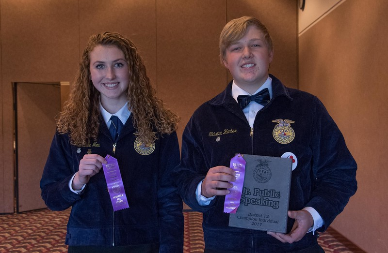 FFA members, from left, MarLee Neu, second, Scottsbluff, and Tristan Hunter, first, of Sioux County High School, pose following the District Leadership Conference in the Chadron State College Student Center Wednesday, Nov. 15, 2017. (Photo by Tena L. Cook/Chadron State College)