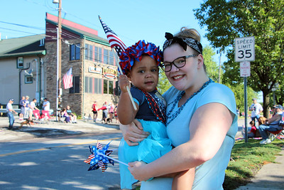 HALEE HEIRONIMUS / GAZETTE Shyla Martin, 2, and mother Shelby Green of Sharon Township went to Hinckley Township's Memorial Day Parade Monday morning.