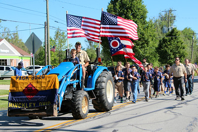 HALEE HEIRONIMUS / GAZETTE Cub Scout Pack 3520 of Hinckley Township march in the township's Memorial Day parade Monday morning.