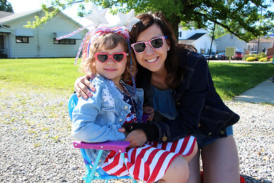 HALEE HEIRONIMUS / GAZETTE Olivia, 4, and Julie McCarthy of Hinckley Township wore patriotic attire Monday morning for the township's Memorial Day parade.