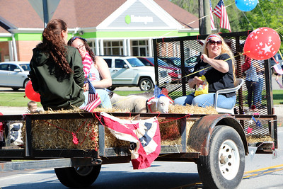HALEE HEIRONIMUS / GAZETTE The Hinckley Township 4-H Spunky Spurs club were joined by two sheep on their trailer for the Memorial Day parade Monday morning.