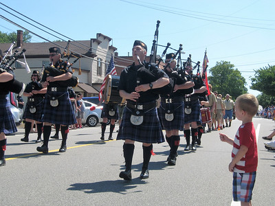 BOB SANDRICK / GAZETTE Blake Bertram, 2, of Medina was enthralled by bagpipers during the Fourth of July parade Tuesday in Liverpool Township.