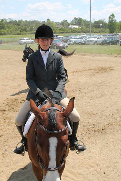LAWRENCE PANTAGES / GAZETTE Emily Malena, 19, of Litchfield Township practices with her bay horse Cody on Monday during the first day of the 2017 Medina County Fair. Malena is a member of the Bravados 4-H Club.