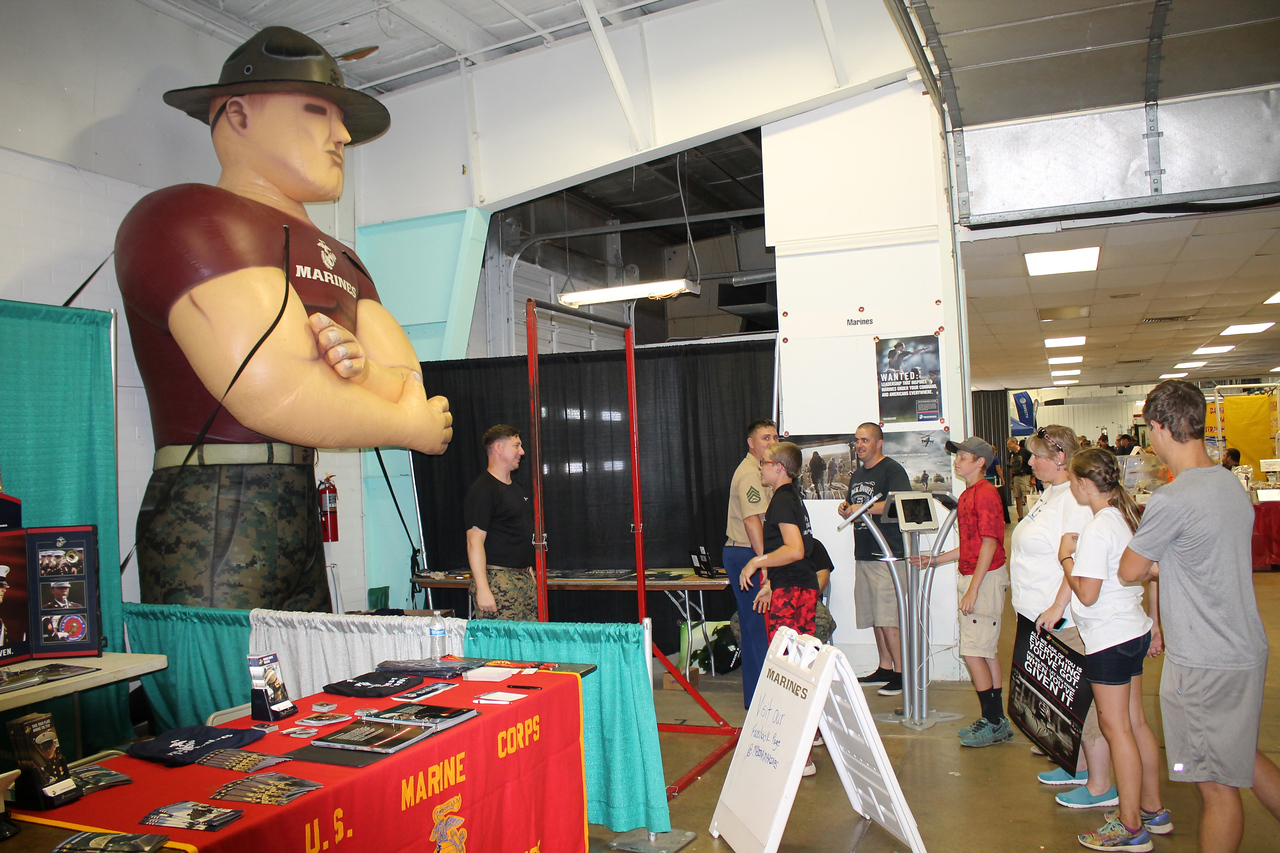 LAWRENCE PANTAGES / GAZETTE A large inflatable Marine helps attract visitors Monday to the service branch's display in the Community Center at the 2017 Medina County Fair.