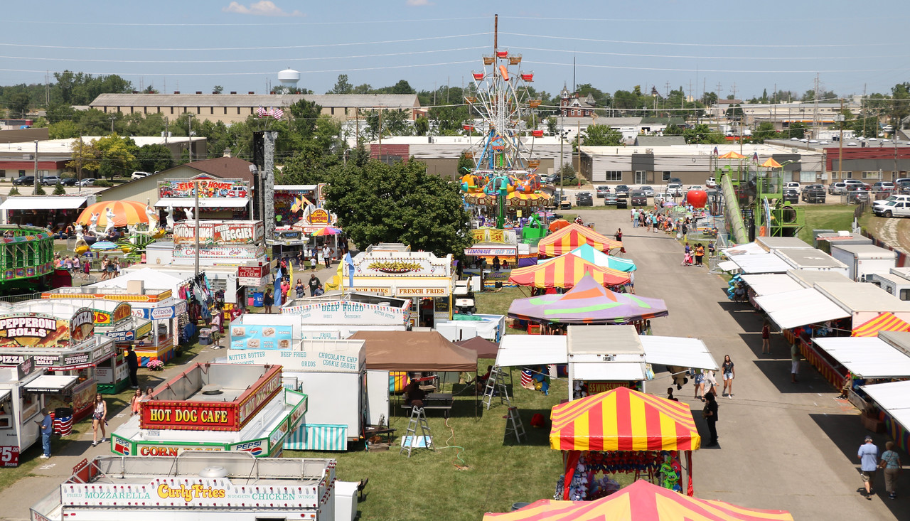 LUCAS FORTNEY / GAZETTE The midway and concession areas of the 2017 Medina County Fair are shown Monday on a bright, sunny day. The weather forecast for today is mostly sunny with a high of 85 degrees.