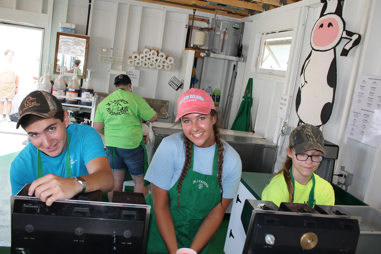 LAWRENCE PANTAGES / GAZETTE Creating milkshakes on Sunday for Medina County Fair visitors who came a day early are Junior Leaders members Caleb Weimer, a home-school student from Seville; Emily George of Buckeye High School and York Township, and Corrine Lecian of Medina High School and Medina.