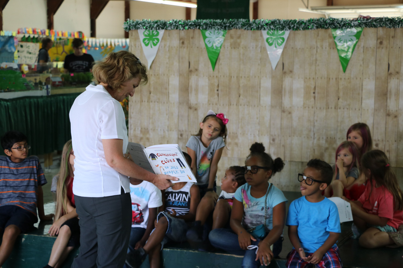 LUCAS FORTNEY / GAZETTE LUCAS FORTNEY / GAZETTE Cathann Arceneaux Kress, the dean of the College of Food, Agricultural, and Environmental Sciences at Ohio State University, reads to children Wednesday on Youth Day of the 2017 Medina County Fair.