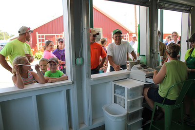 LAWRENCE PANTAGES / GAZETTE The Junior Leaders milkshake booth is busy Sunday, a day before the start of the 2017 Medina County Fair. All money taken in Saturday and Sunday is being divided between two nonprofits — Feeding Medina County and Cups Cafe — officials said.
