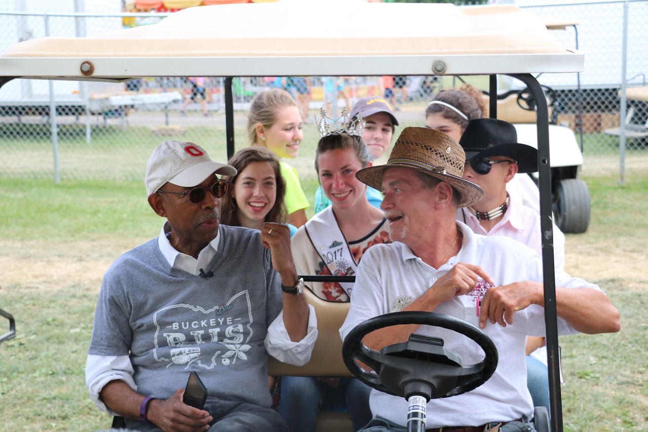 LUCAS FORTNEY / GAZETTE Medina County Fair Board Vice President Stuart Neal and President of the Ohio State University Dr. Michael Drake pile into a golf cart with the Medina County Fair Royal Court and Junior Fair Board during Drake's visit to the 2017 event on Wednesday.