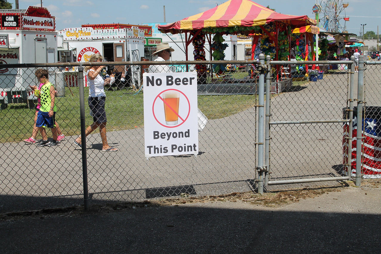 LAWRENCE PANTAGES / GAZETTE Signs remind Beer Garden customers at the Medina County Fair where consumption is permitted.