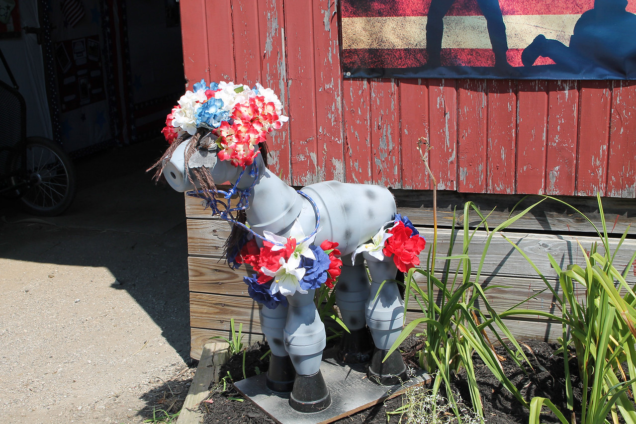 LAWRENCE PANTAGES / GAZETTE A toy horse is dressed in red, white and blue outside Barn 9 on Sunday, the day before the start of the 2017 Medina County Fair.