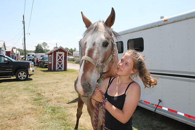 LAWRENCE PANTAGES / GAZETTE Kyra Moye, 14, of Montville Township, brings Bandit into a barn Sunday for the start of the 2017 Medina County Fair. Moye, who will be a freshman student at Medina High School this fall, is entered in competitions for jumping, barrel, English, Western pleasure and equitation.