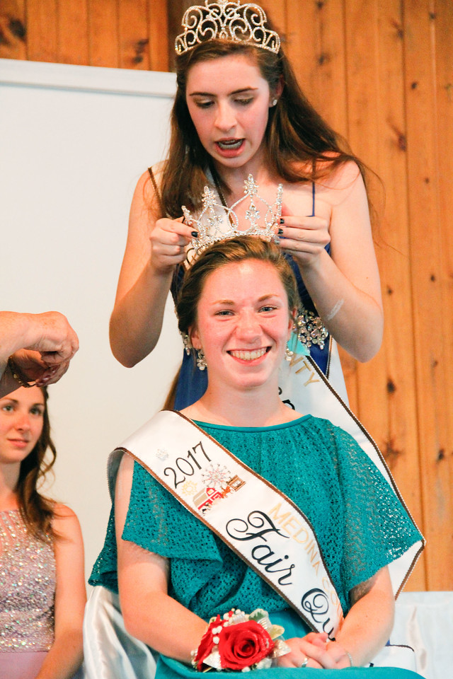 ALEC SMITH / GAZETTE Kelsey C. Hurley, Medina, was crowned 2017 Medina County Fair Queen Monday night by 2016 Medina County Fair Queen Lydia Mainzer.