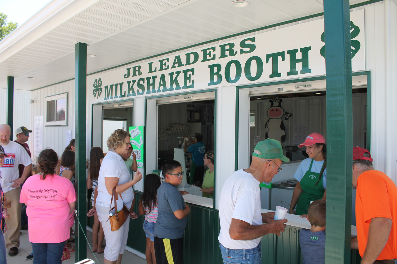 LAWRENCE PANTAGES / GAZETTE The Junior Leaders milkshake booth is busy Sunday, a day before the start of the 2017 Medina County Fair. All money taken in Saturday and Sunday is being divided between two nonprofits -- Feeding Medina County and Cups Cafe -- officials said.
