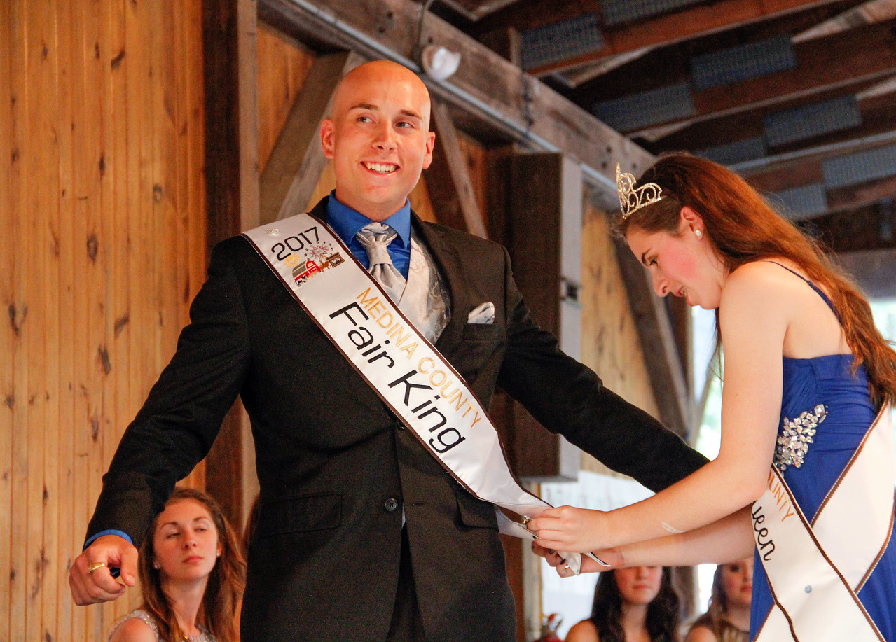 ALEC SMITH / GAZETTE Jeremiah A. Kreuder, Medina, was crowned 2017 Medina County Fair King Monday night. The 2016 Medina County Fair Queen Lydia Mainzer is shown pinning the sash on Kreuder.