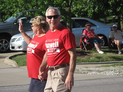 Medina Mayor Dennis Hanwell walks in the annual Independence Day parade. BOB FINNAN / GAZETTE