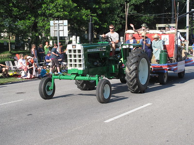 A tractor pulls a float in the Medina Independence Day Parade. BOB FINNAN / GAZETTE