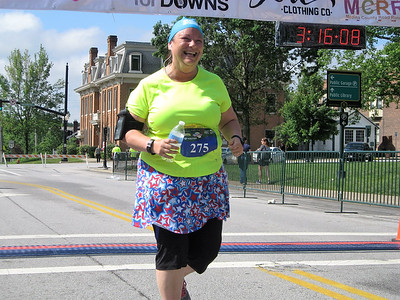BOB SANDRICK / GAZETTE Judy Schmidt of LaGrange cannot hold back a wide smile as she finished the Medina Half Marathon on Saturday.