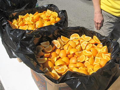 BOB SANDRICK / GAZETTE Plenty of oranges await runners Saturday at the end of the half marathon held in Medina.