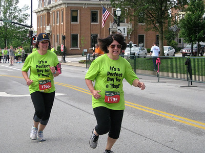 BOB SANDRICK / GAZETTE Two more runners finish the half-marathon Saturday in Medina.