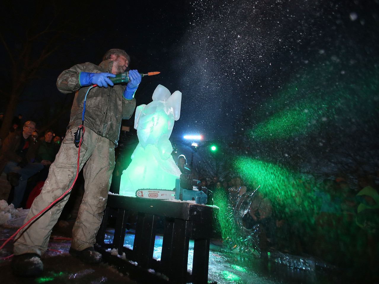 AARON JOSEFCZYK / GAZETTE  Jim Duggan of Atlanta works on an ice sculpture that was judged a winner in a competition held Friday on Medina Public Square during the first day of the 23rd Medina Ice Festival.